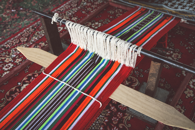 A traditional, simple, Arab loom set up to produce the sort of cloth that is common throughout the Arab world.